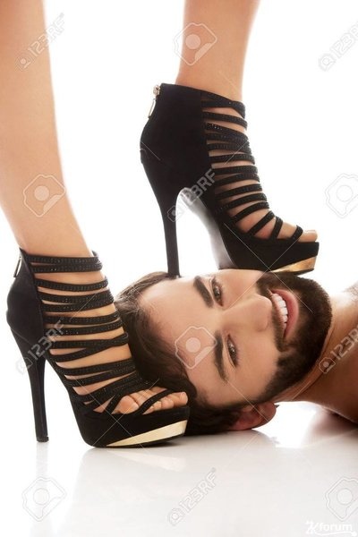 54159960-sexy-woman-s-foot-in-high-heel-on-man-s-face-dominating-him-.jpg