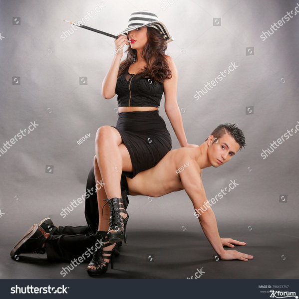 stock-photo-dominant-woman-sits-on-dominated-man-796473757.jpg